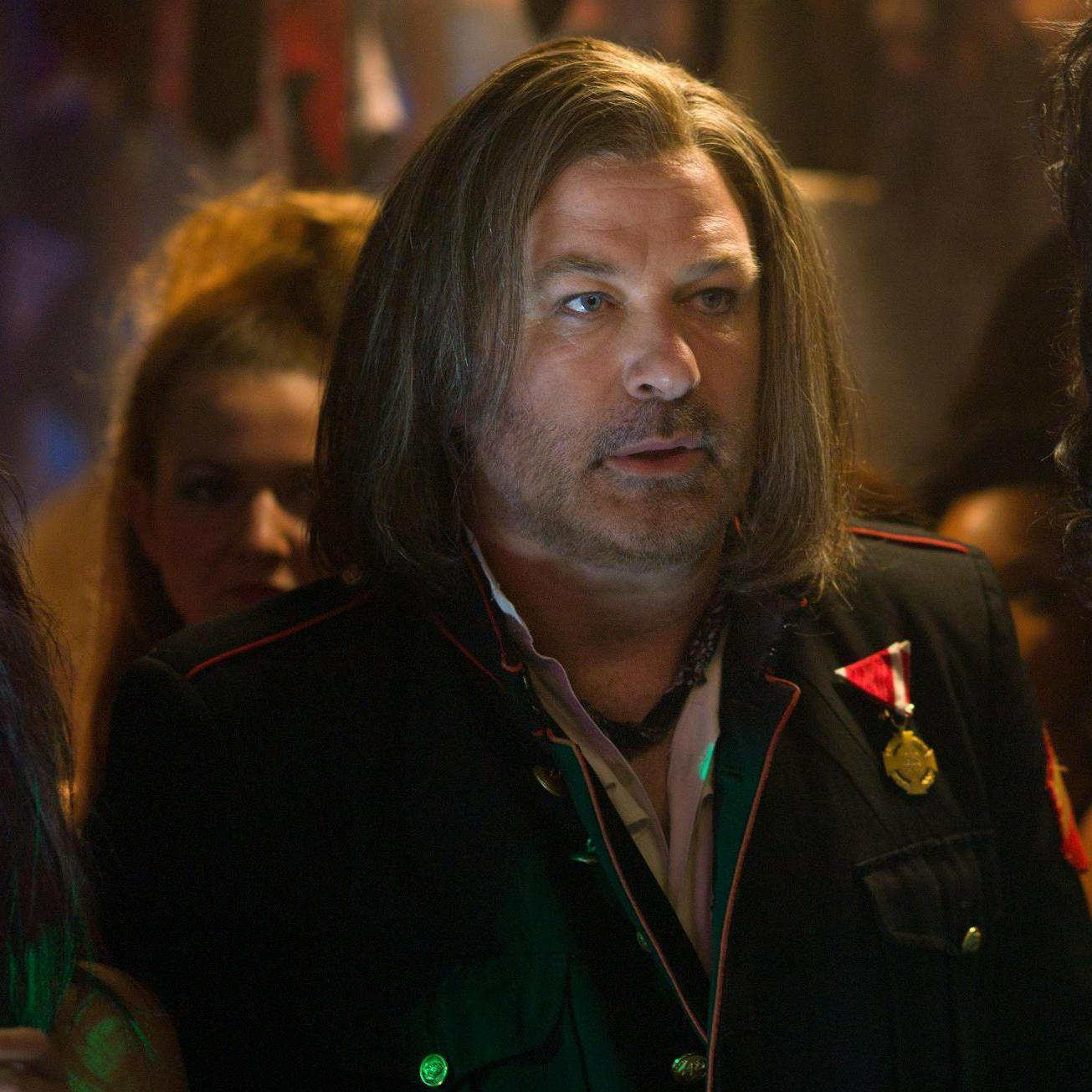 Club owner Dennis Dupree (Alec Baldwin, left) and his assistant Lonny Barnett (Russell Brand) try to figure out a way to keep their nightclub open in the movie adaptation of Rock of Ages.
