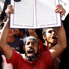 A protester holds a Quran at a Salafi rally for the enforcement of Islamic Shariah law last fall in Cairo's Tahrir Square. Repressed during the rule of President Hosni Mubarak, the country's ultra-conservative Salafis have seen a resurgence since the Arab Spring uprising.