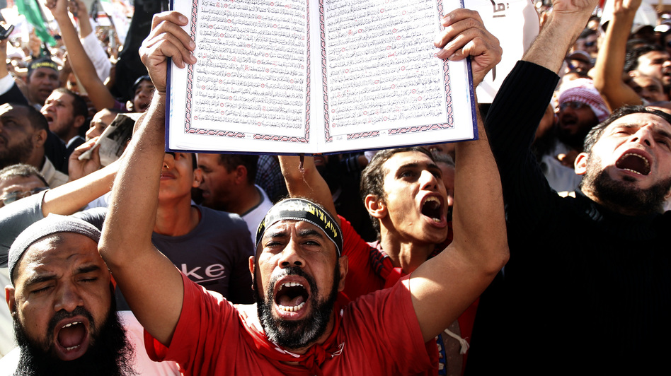 A protester holds a Quran at a Salafi rally for the enforcement of Islamic Shariah law last fall in Cairo's Tahrir Square. Repressed during the rule of President Hosni Mubarak, the country's ultra-conservative Salafis have seen a resurgence since the Arab Spring uprising. (Reuters/Landov)