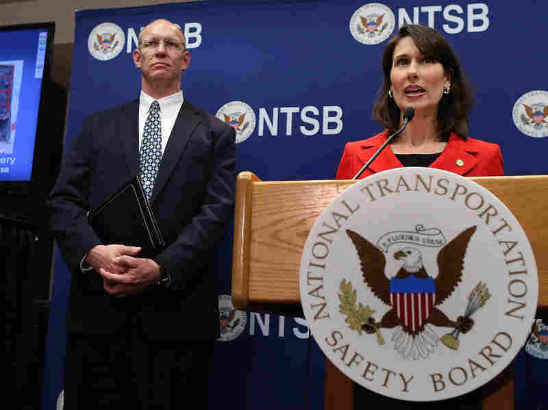 National Transportation Safety Board Chairman Deborah Hersman speaks as NTSB Aviation Safety Director John DeLisi looks on during a news briefing on the Boeing 787 investigation Thursday.