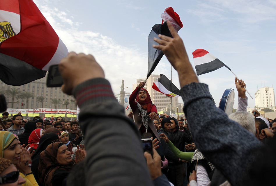 Egyptian demonstrators wave the national flag and shout slogans during a protest in Tahrir Square on January 25, 2013 in Cairo. (AFP/Getty Images)