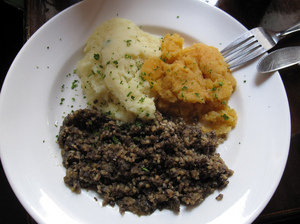 Haggis is traditionally served with mashed neeps and tatties, or turnips and potatoes.