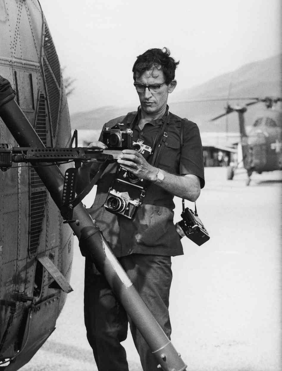 Life photographer Larry Burrows (1926-1971) attaches cameras to helicopter Yankee Papa 13 prior to a mission during the Vietnam War in 1965.