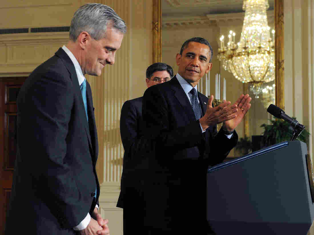 """New White House Chief of Staff Denis McDonough (left), at Friday's announcement. Behind the president: outgoing Chief of Staff Jacob """"Jack"""" Lew, who has been nominated to be Treasury secretary."""
