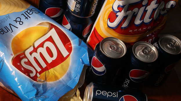 PepsiCo's product line ranges from salty chips and its sugary namesake drink to more healthful fare like hummus and yogurt. In 2010, the company announced plans to cut sugar, fat and sodium in its products to address health and nutrition concerns. (Getty Images)