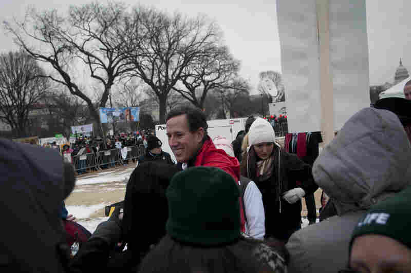Former GOP presidential contender Rick Santorum greets participants after speaking to a crowd of anti-abortion activists during today's March for Life rally.