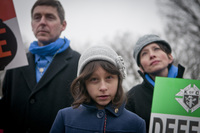 Lucia Dragas, 8, from Boston, Mass., held a poster saying