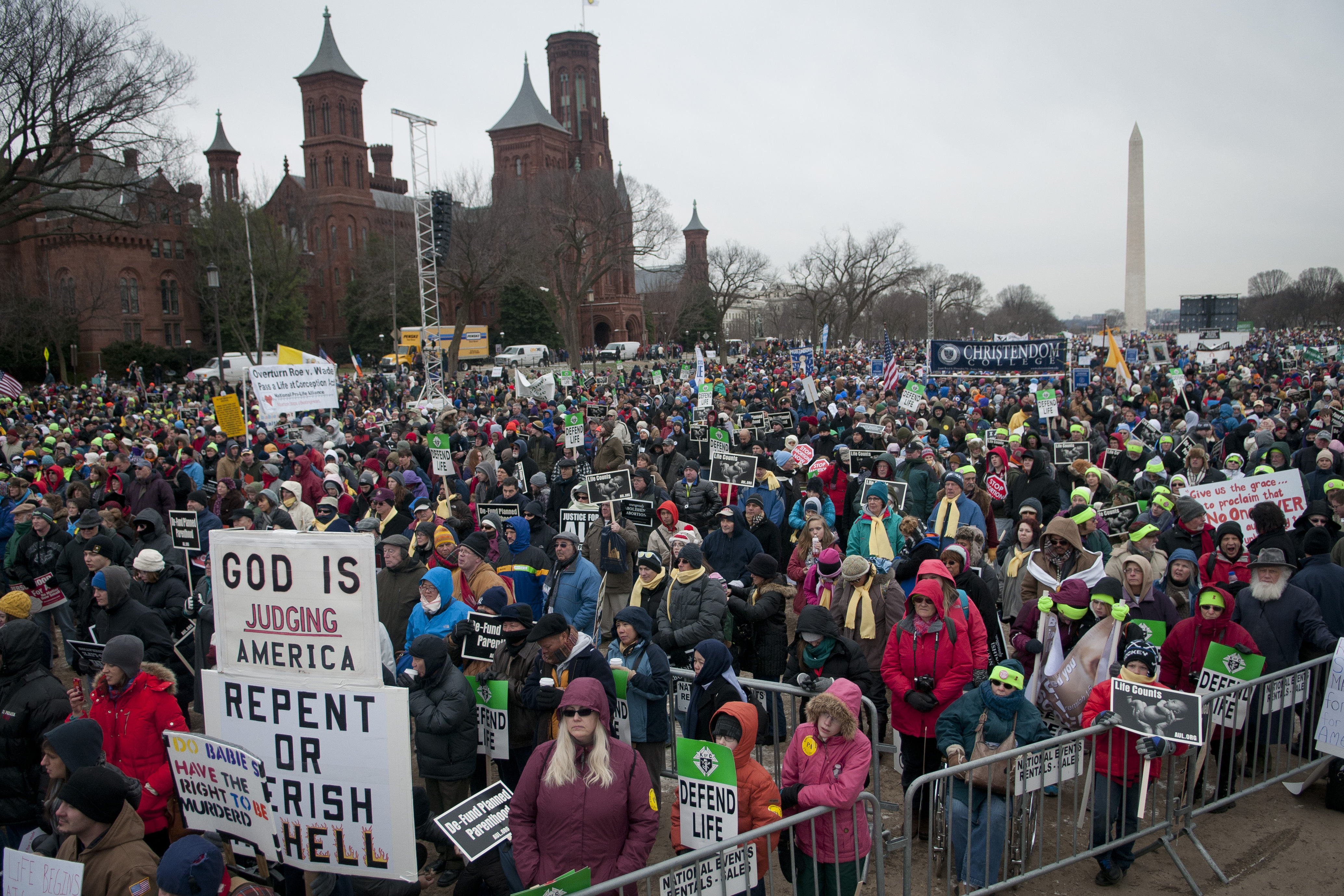 Participants braved wind and snow flurries to gather at the March for Life rally.