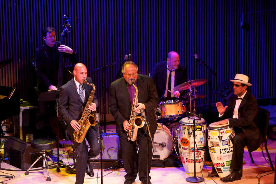 "Saxophonist Joe Lovano (center) played his piece ""Blackwell's Message"" with fellow saxophonist Joshua Redman, bassist Matt Penman, drummer Jeff Ballard and conguero John Santos."