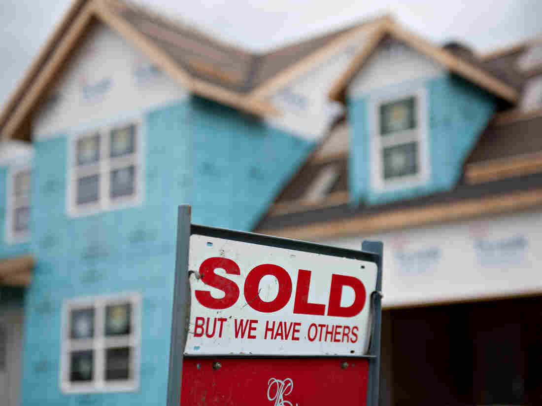 """A """"sold"""" sign outside a home under construction last fall in Peoria, Ill."""