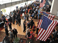 Hundreds of veterans and military spouses meet with prospective employers at the Hiring Our Heroes job fair at Nationals Park in Washington, D.C., in December. Veterans say they're still having trouble finding jobs and getting other types of assistance.