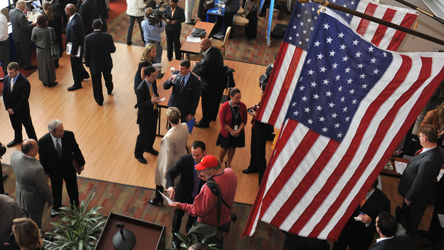 Hundreds of veterans and military spouses meet with prospective employers at the Hiring Our Heroes job fair at Nationals Park in Washington, D.C., in December. Veterans say they're still having trouble finding jobs and getting other types of assistance. (AP/National Chamber Foundation )