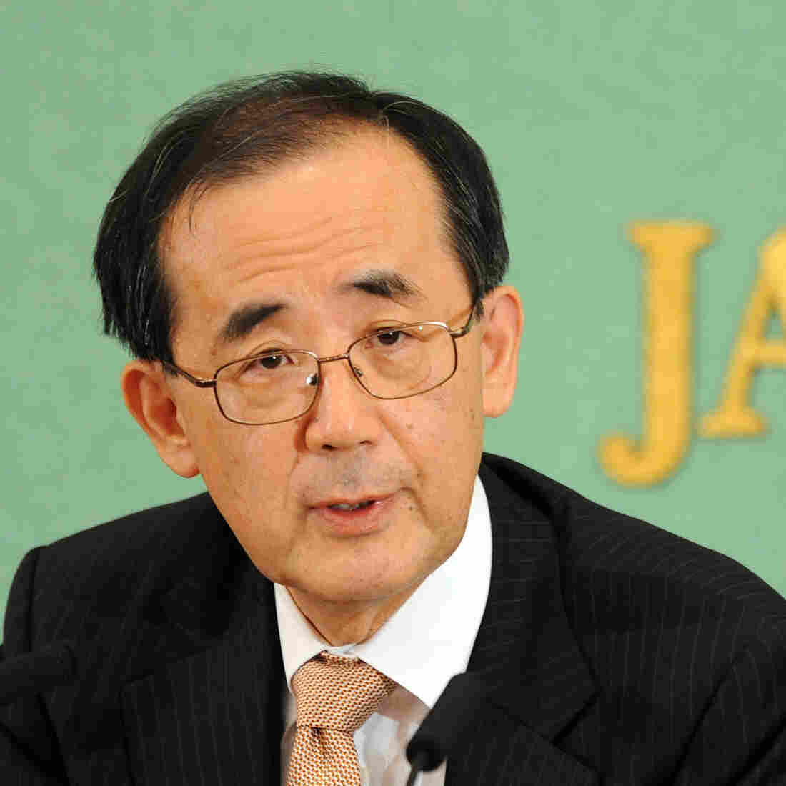 Masaaki Shirakawa, the governor of the Bank of Japan, speaks before the press in Tokyo on Friday. The central bank announced new measures to stimulate the economy Tuesday.