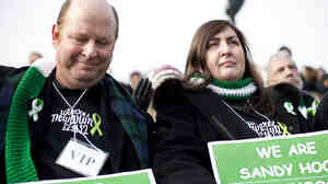 Newtown, Conn., residents Darren Wagner and Georgia Monaghan traveled to Washington, D.C., to attend the gun control rally on Saturday.