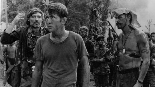 Dennis Hopper, Martin Sheen, and Frederic Forrest survey a temple in a scene from Francis Ford Coppola's Apocalypse Now. (Getty Images)