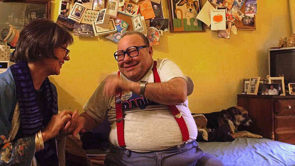 Alice Elliott, producer of the documentary The Collector of Bedford Street, laughs with Larry Selman in 2003. Selman died J