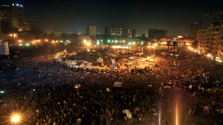 Thousands of Egyptian protesters gather in Cairo's Tahrir Square on Friday, marking two years since the start of the country's revolution. (AP)