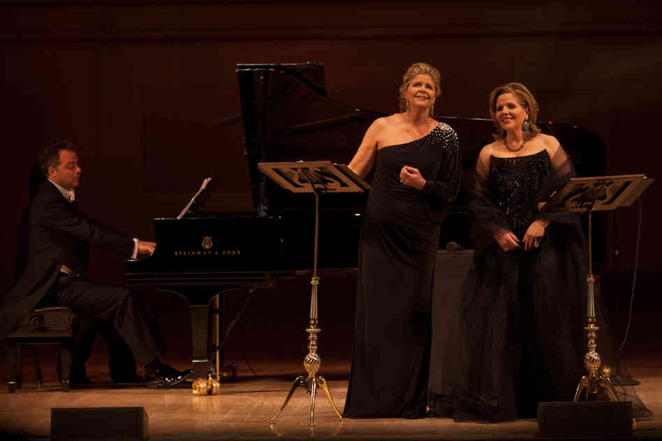Soprano Reneé Fleming (right) and mezzo-soprano Susan Graham (with pianist Bradley Moore) turned Carnegie Hall into cozy Parisian salon by singing an evening of French songs and opera duets.