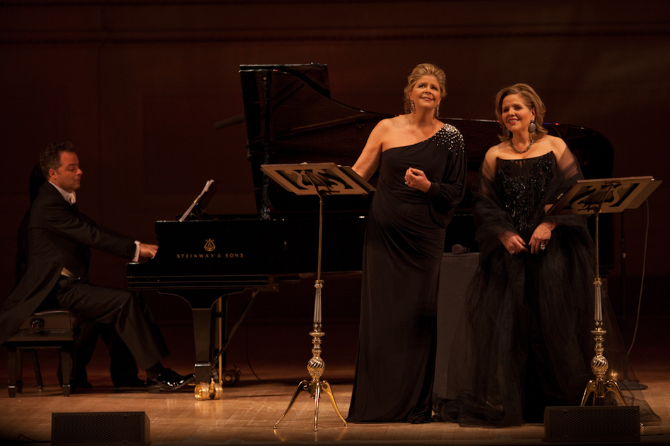 Soprano Reneé Fleming (right) and mezzo-soprano Susan Graham (with pianist Bradley Moore) turned Carnegie Hall into cozy Parisian salon by singing an evening of French songs and opera duets. (NPR)
