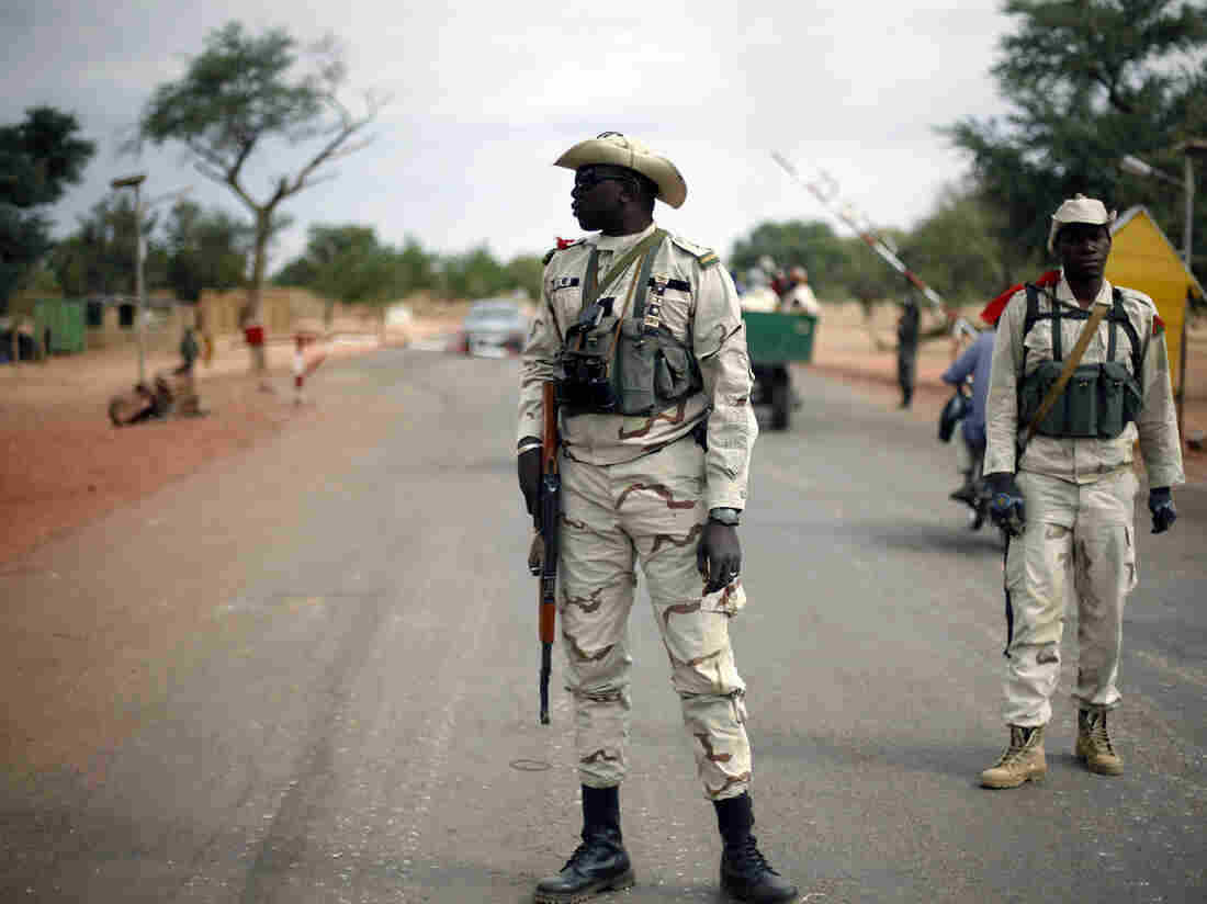 Malian soldiers man a checkpoint on the Gao road outside Sevare, some 385 miles north of Mali's capital, Bamako, on Sunday.