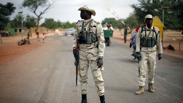 Malian soldiers man a checkpoint on the Gao road outside Sevare, some 385 miles north of Mali's capital, Bamako, on Sunday. (AP)