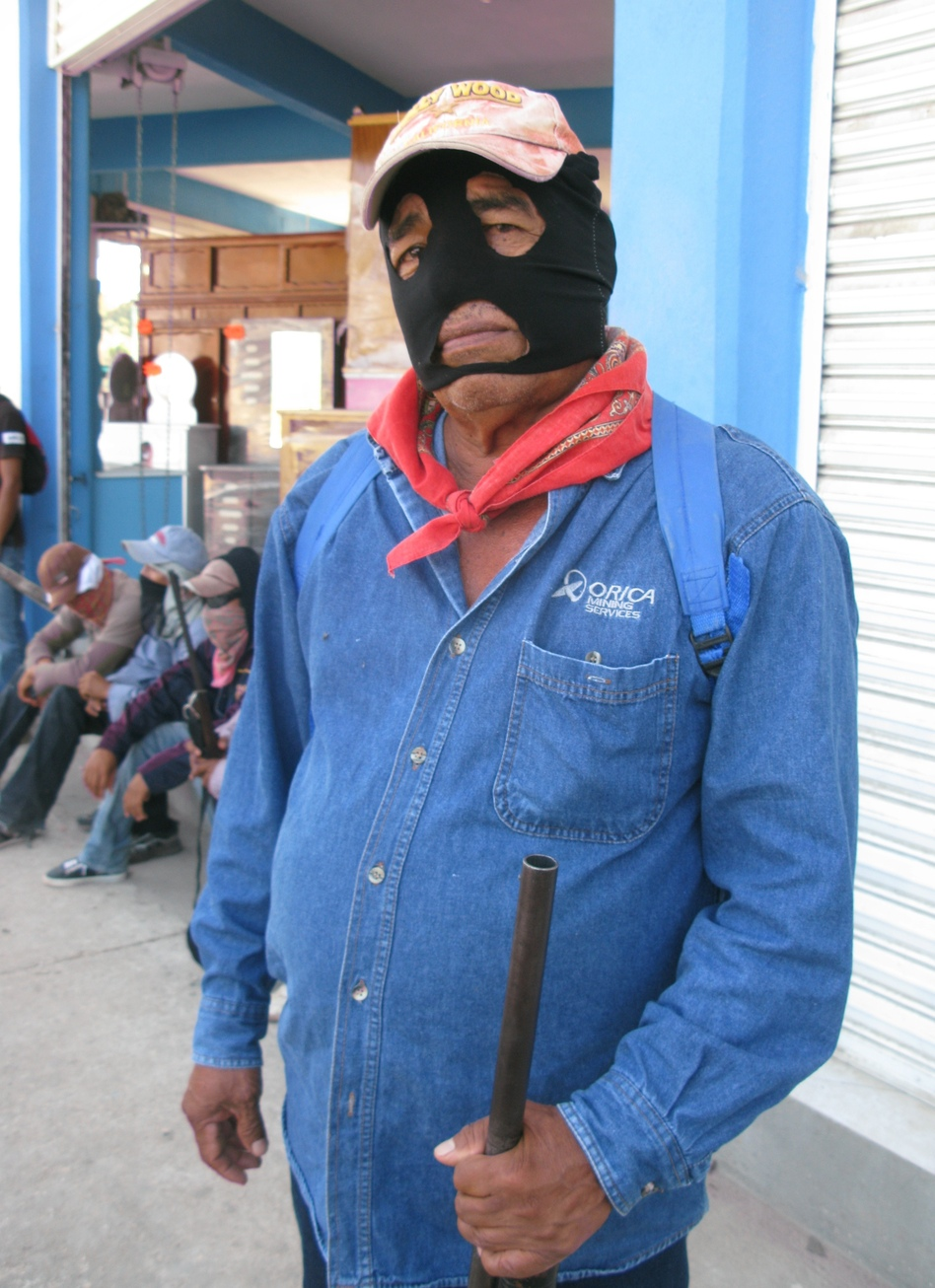 A man who identifies himself as a lower commander in Ayutla's self-defense brigade says residents had no choice but to take up arms. (NPR)