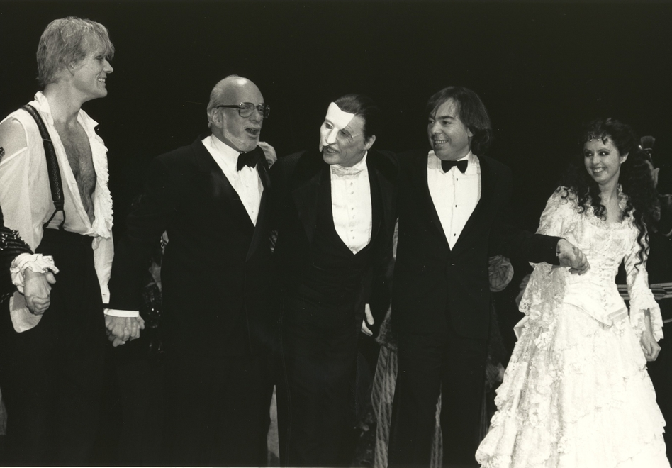 Opening night curtain call, Jan. 26, 1988, features Steve Barton  (Raoul), Harold Prince, Michael Crawford (The Phantom), Andrew Lloyd Webber and Sarah Brightman (Christine). (Courtesy of The Phantom Company)