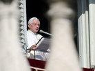 "Pope Benedict XVI leads prayers on Nov. 27, 2011, in St. Peter's Square at the Vatican. The leader of the world's Roman Catholic Church called for a ""responsible, credible and united response"" to the problem of climate change. But in the U.S. at least, studies show the view even of religious Americans on climate change is much more likely to be shaped by their politics than their faith."