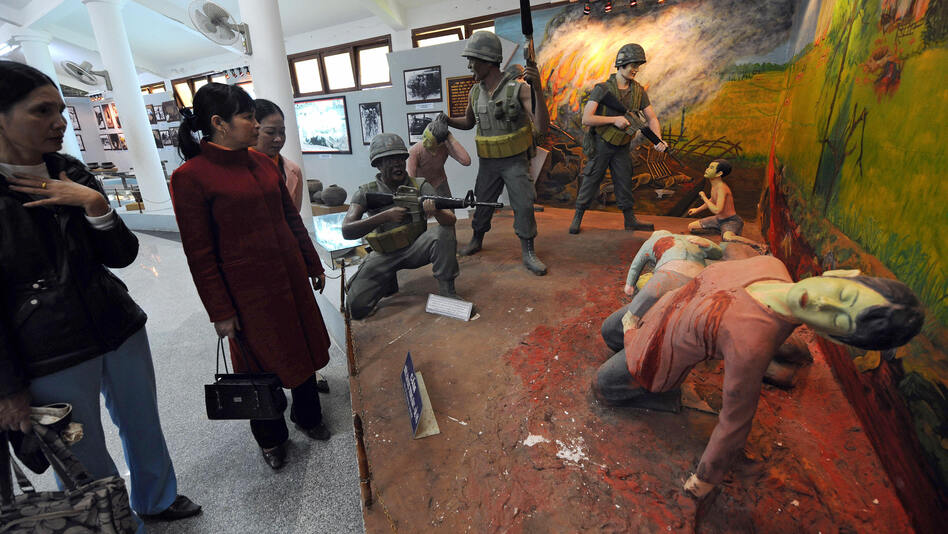 Visitors take in a re-created scene at the massacre museum at Vietnam's My Lai village. Researcher Nick Turse says atrocities of all kinds were more common in the Vietnam War than most Americans believe. (AFP/Getty Images)