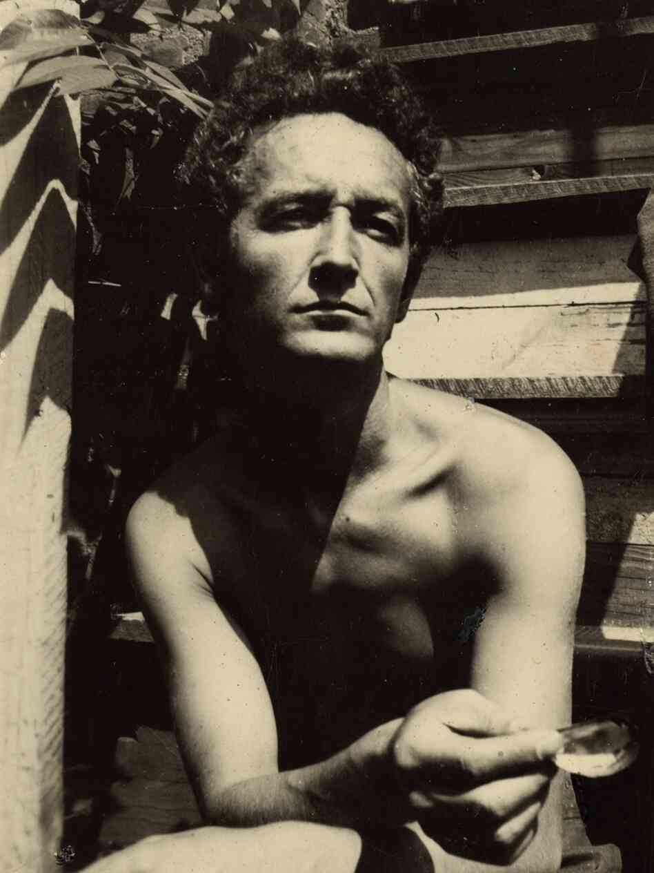 The folk balladeer Woody Guthrie, shown here at his home on Mermaid Avenue in Coney Island in 1950, was also a prolific writer and visual artist.