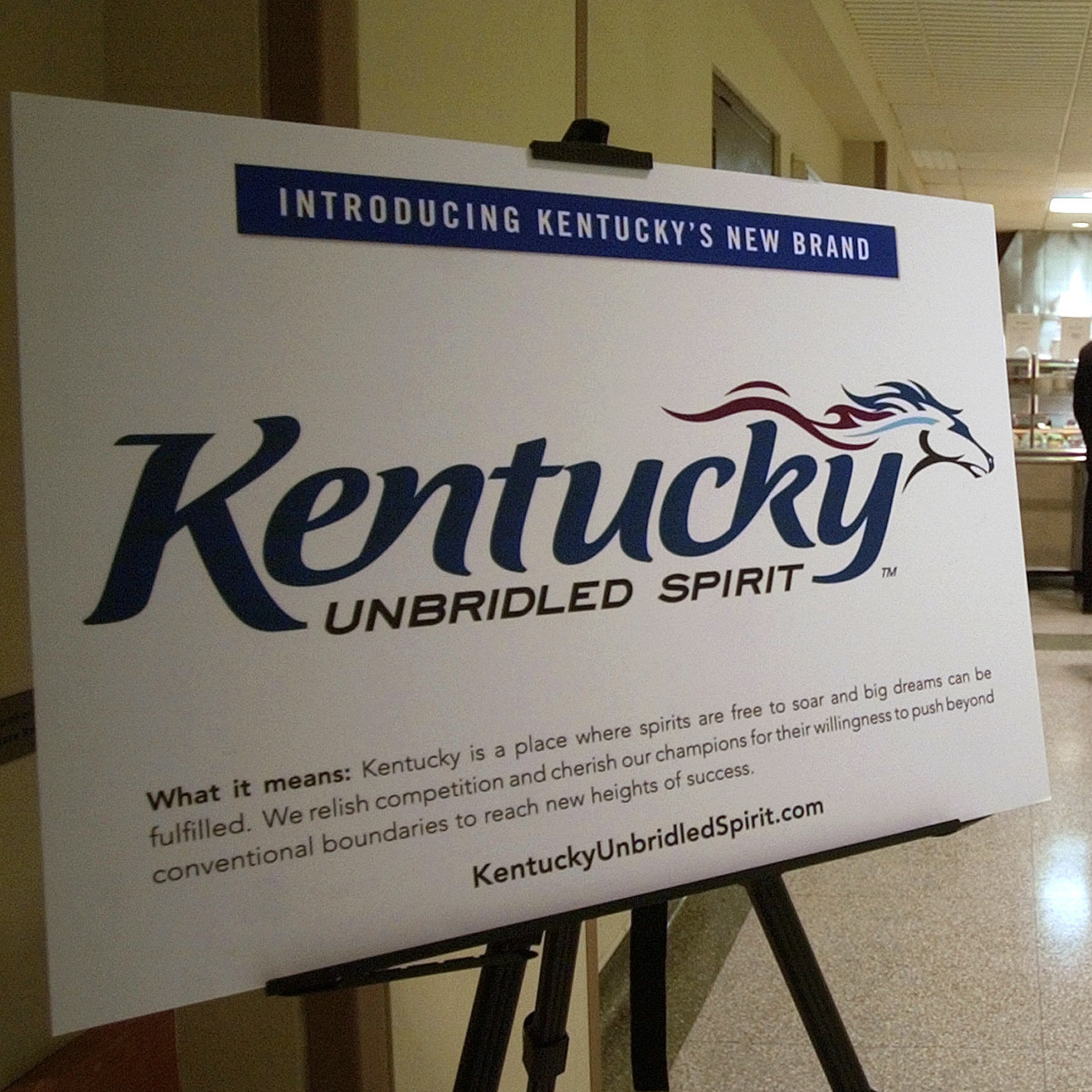 A display showing Kentucky's current logo and slogan, and explaining what it means, sits in the Capitol Annex cafeteria in 2005.