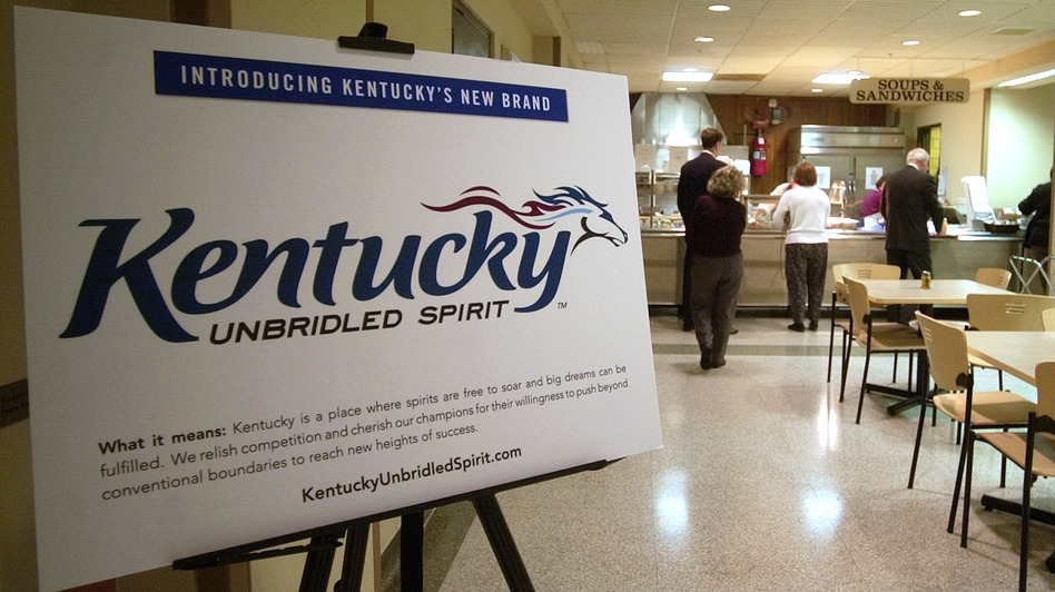 A display showing Kentucky's current logo and slogan, and explaining what it means, sits in the Capitol Annex cafeteria in 2005. (AP)