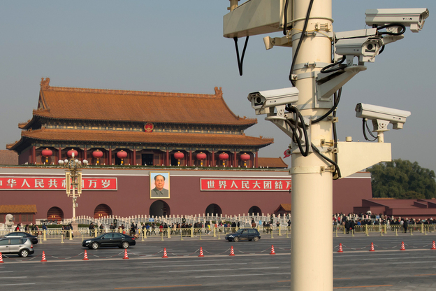 The use of security cameras such as these, looking out over Tiananmen Square in Beijing, is on the rise in China. Critics say the government is using them to discourage dissident.