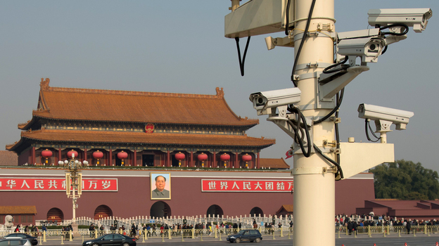 The use of security cameras such as these, looking out over Tiananmen Square in Beijing, is on the rise in China. Critics say the government is using them to discourage dissidents. (AFP/Getty Images)