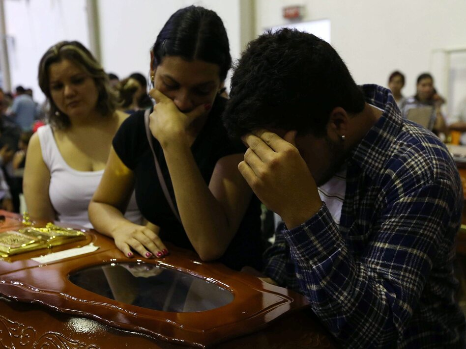 Mourners at the coffin of one victim of the fire at the Kiss nightclub in southern Brazil.