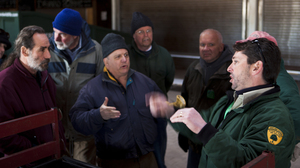 Ray Bukowski (far right), manager of Island Beach State Park, organizes members of the New Jersey Beach Buggy Association.