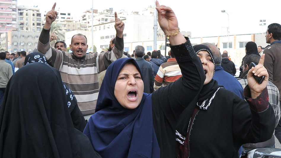 Mourners shouted during a funeral procession today in Port Said, Egypt, for some of those killed during Saturday's protests. (AFP/Getty Images)