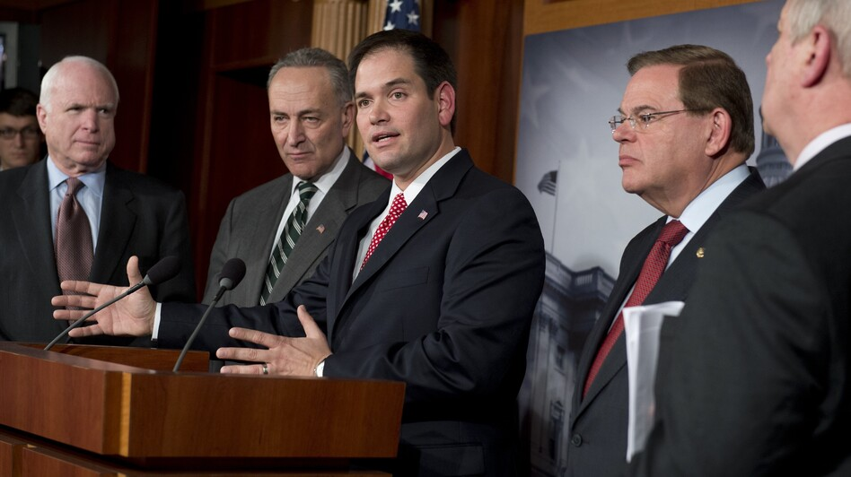 Five of the eight senators who proposed a bipartisan plan for an immigration overhaul attend a Capitol Hill news conference Monday. From left are John McCain of Arizona, Chuck Schumer of New York, Marco Rubio of Florida, Robert Menendez of New Jersey and Dick Durbin of Illinois. (AFP/Getty Images)