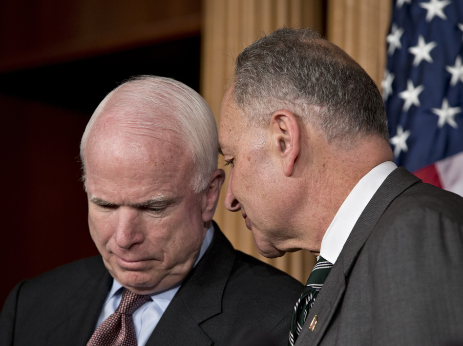 Sens. John McCain, R-Ariz., and Charles Schumer, D-N.Y., are closer on the immigration issue than McCain is to many in his party. They were among the eight senators who announced the framework for a bipartisan immigration overhaul on Monday. (AP)