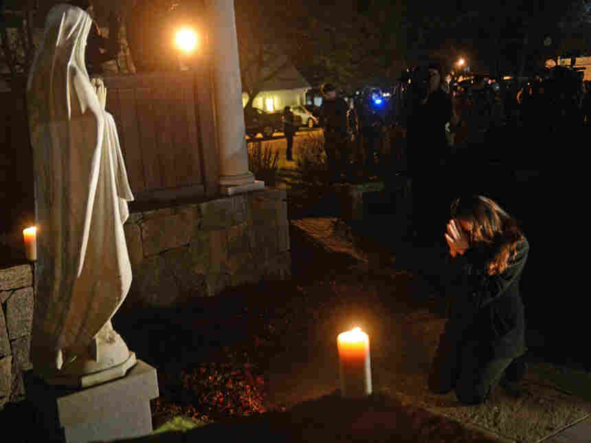 This photograph of Aline Marie praying outside St. Rose of Lima church in Newtown, Conn., has become the focus of a conversation surrounding ethics and photography on NPR's Picture Show blog.