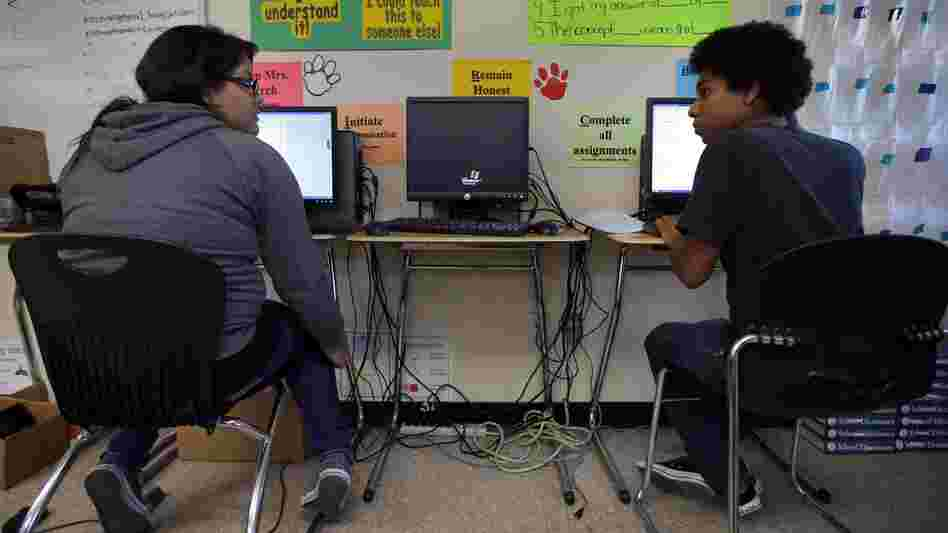 Mariah Arostigue (left) and Noah Reyes, 11th-graders, chat as they work on their homework in a pre-calculus class at Segerstrom High School in Santa Ana, Calif.