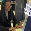Nkomo Morris, a teacher at Brooklyn's Art and Media High School, works on her classroom computer in New York.