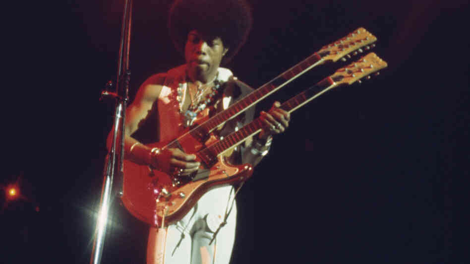 Leroy 'Sugarfoot' Bonner of the Ohio Players plays a double-necked guitar during a concert performance in 1970. Bonner died Friday at age 69.