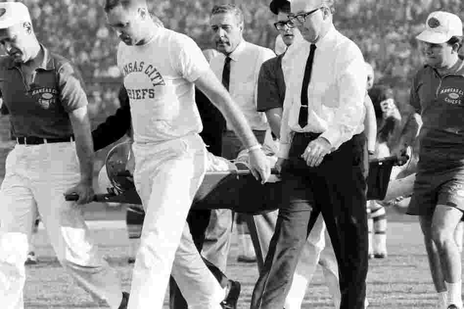 "Kansas City's injured Fred ""The Hammer"" Williamson is carried off the field."