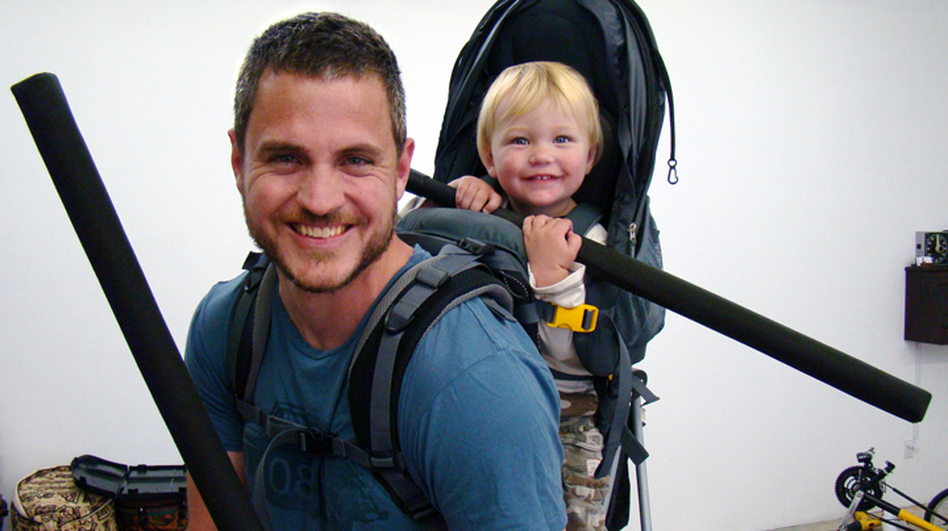 Sam Sheridan, shown here with his son Asa, is an amateur boxer and MMA fighter. He has worked in construction in Antarctica and as a cowboy and farmhand in Montana. (Courtesy Penguin Press)