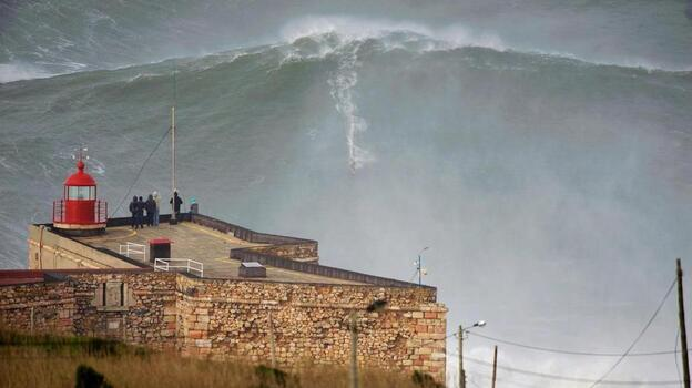 Garrett McNamara surfs a huge wave in Nararé, Portugal. (via Twitter)