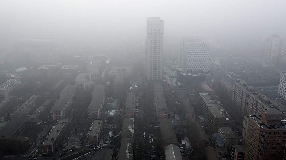 Downtown Beijing in the clouds of its latest air pollution emergency. (Getty)
