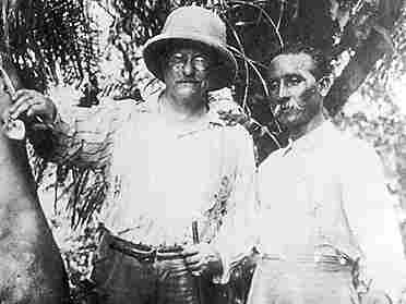 Teddy Roosevelt stands between a bush deer and Brazilian explorer Candido Rondon in a photograph taken before their party reached the River of Doubt. (Theodore Roosevelt Collection, Harvard College Library)