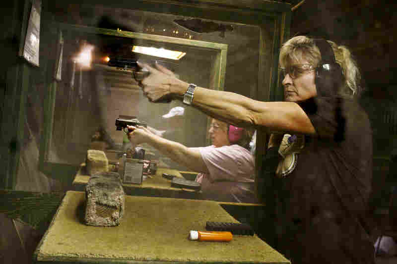 """Renee Blaine fires her gun during shooting practice. Crowder says that a majority of the women who come to these events """"use this as their 'girl time' away from the daily grind, the house, job, husband and kids."""""""