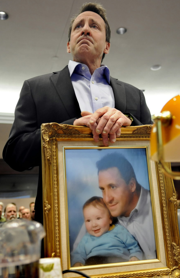 Neil Heslin brought a framed photo of himself and his son Jesse (when the boy was an infant) to Monday's hearing in Hartford, Conn. The 6-year-old was killed at Sandy Hook Elementary School in December's shooting.